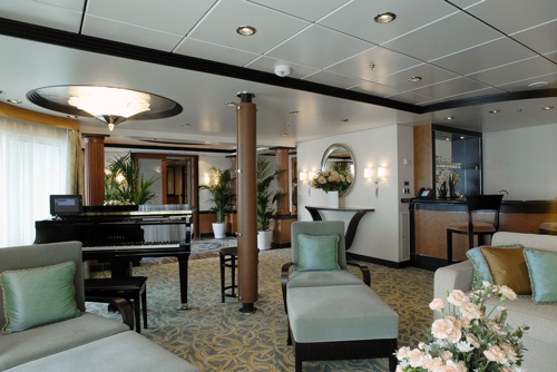 Royal Caribbean features some 2,000 suites across its 20-ship fleet. The line will be unveiling a host of new suite amenities beginning in March. The Royal Suite, pictured here, features a digital baby grand player piano, a bar and panoramic sea views through a glass panel wall that spans the length of the suite. Image courtesy Royal Caribbean