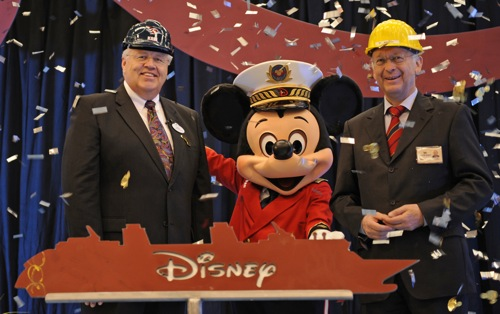 Capt. Mickey along with Disney Cruise Line President Karl Holz and Meyer Werft Managing Partner Bernard Meyer celebrate Disney Cruise Line's first steel cutting ceremony at the Meyer Werft shipyard in Papenburg, Germany.