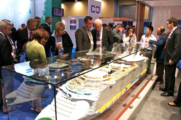 Crowds gather around a model of Oasis of the Seas.