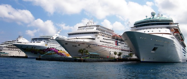 Four cruise ships, from left, Regent Seven Seas Navigator, Norwegian Sky, Carnival Sensation and Royal Caribbean's Majesty of the Seas are shown docked under sunny skies in Nassau, Bahamas, Tuesday March 31, 2009.