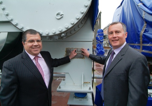 Oceania Cruises' executives Frank Del Rio, left, and Bob Binder celebrate the birth of Oceania's newest ship - Marina - during a keel laying ceremony in Italy over the weekend.