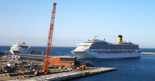 Costa Magica arrives at sun-up at the still-under-construction cruise terminal in Malaga, Spain, Tuesday May 12, 2009.