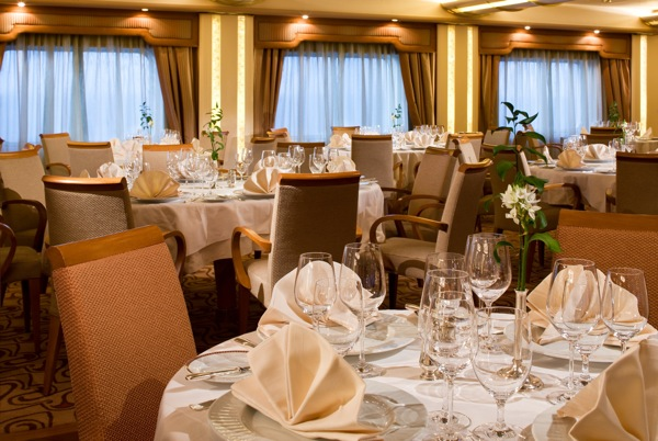 The Restaurant, Silver Wind's main dining venue, is but one on board locale featuring new upholstery, carpet, wall and window treatments. The look may be new for guests this week on a 10-night Mediterranean itinerary but a Silversea staple — impeccable service — remains the same. Image courtesy Silversea