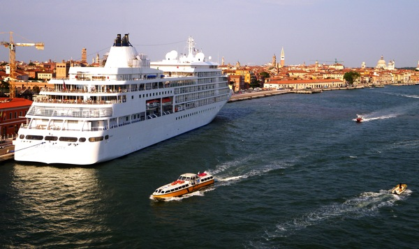 Silver Whisper, one of five ships in the Silversea Cruises fleet, is shown docked earlier this week in Venice, Italy. A sixth ship, Silver Spirit, debuts later this year. The line is offering 60 percent savings on 2010 voyages. Image courtesy Michael Coleman