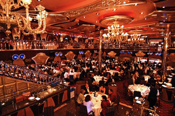 """The two-deck Golden Olympian Dining Room features 6 p.m. and 8:15 p.m. service for passengers aboard Carnival Liberty. Passengers may also opt for """"Your Time Dining'' where they may dine when and with whom they choose between 5:45 to 9:30 p.m. Photo courtesy CCL."""
