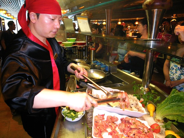 The food choices aboard Carnival Liberty are virtually endless but the most popular venue — the ship's Mongolian Wok featuring made-to-order fresh vegetables, noodles and choice of salmon, beef, pork, shrimp or chicken — is by far a passenger favorite. Photo by Michael Coleman.